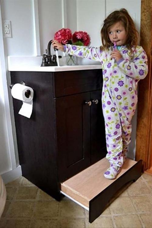 28.) Use a slide-away step in your bathroom instead of a stepstool.
