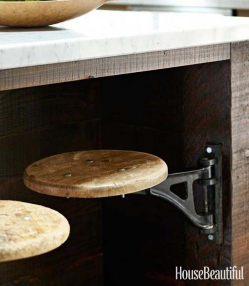 29.) Stools on hinges save room in the kitchen.