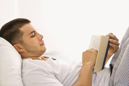 04-man-reading-book-in-bed