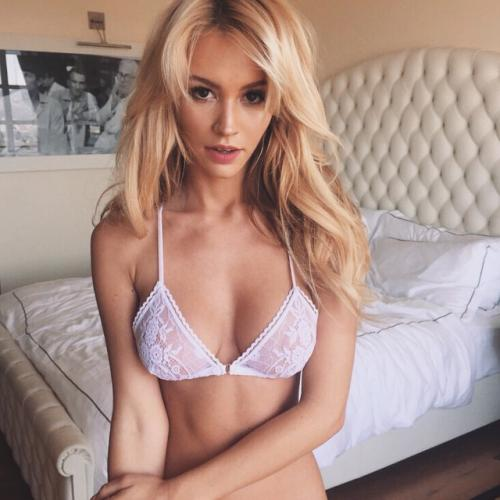 Sexy blonde fashion model Bryana Holly hot in a lacy white bra in the bedroom